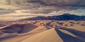 A view of the sand dunes and Sangre de Cristo mountains at sunset in the Great Sand Dunes National Park, Colorado USA
